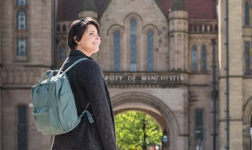 Female student in front of archway